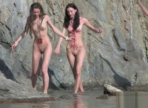 Bare maiden naturist gang out on beach..